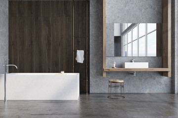 Gray and dark wooden bathroom, tub