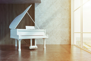 White piano in a concrete and wooden room toned
