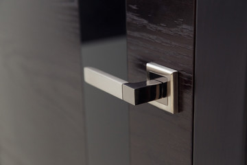 Closeup handle. Modern door handle, tilt view. Wall mural