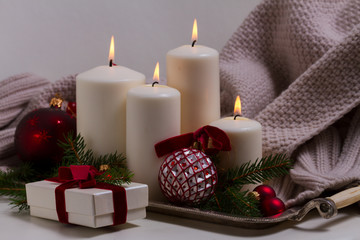 White burning advent candles with christmas decorations