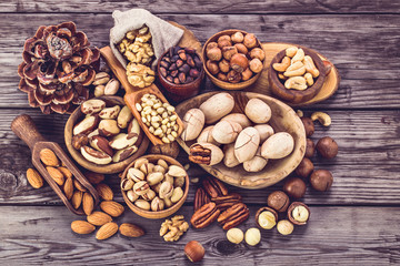 Variety of fresh nuts on old rustic table