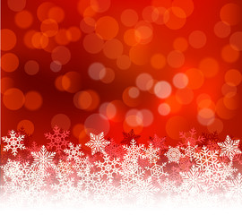 Winter red bokeh xmas background with snowflakes. Christmas bokeh holiday decoration for greeting card