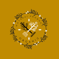 Logo for organic food store,gardering. Pitchfork and rake in the branches. Vector illustration