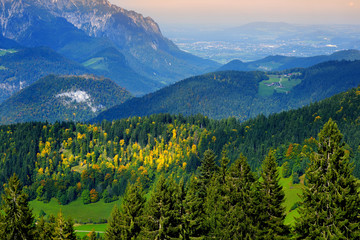 Breathtaking lansdcape of mountains, forests and small Bavarian villages in the distance. Scenic view of Bavarian Alps with majestic mountains in the background.