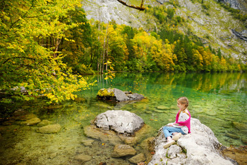 Fototapete - Little girl enjoying the view of deep green waters of Obersee, located near Konigssee, known as Germany's deepest and cleanest lake, Germany