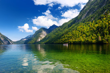 Fototapete - Stunning deep green waters of Konigssee, known as Germany's deepest and cleanest lake, located in the extreme southeast Berchtesgadener Land district of Bavaria