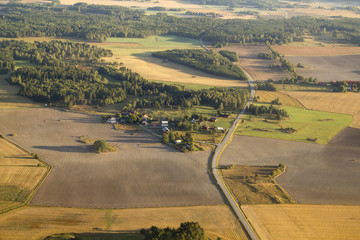 Aerial view of green rural landscape and houses in Sweeden