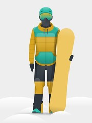 Snowboarder in equipment holding his board