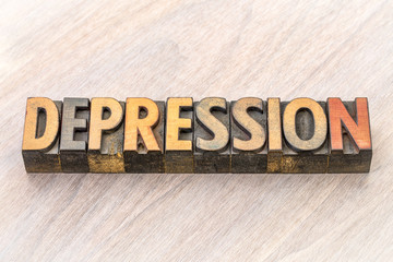 depression word abstract in wood type