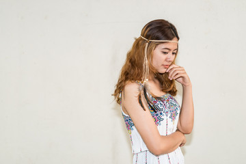 Portrait of asian bohemian girl on white wall,thailand people,hippie girl