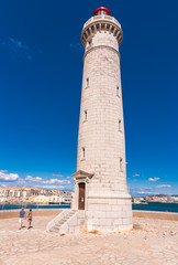 Stunning harbour of Sete with lighthouse in the south of France near the Mediterranean. Copy space for text. Vertical.