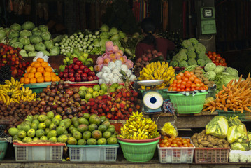 Colorful Balinese Market with Fruits and Vegetables. A roadside market in the village of Ubud, Bali.