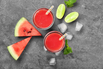 Glasses of fresh watermelon smoothie on table