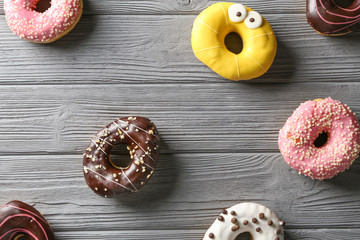 Tasty donuts on wooden table
