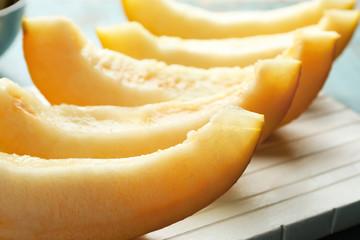 Ripe melon on wooden board
