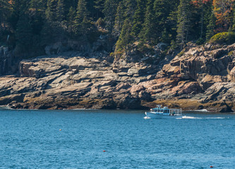 White Lobster Boat Along Rocky Maine Coast