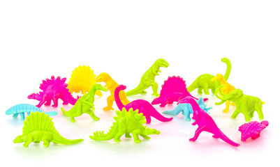 Pack of colorful dinosaur toy on white background