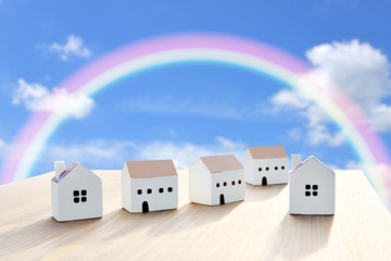 Miniature houses and rainbow