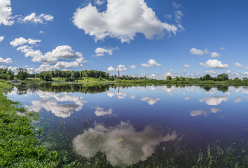 River and white clouds above it on a summer day