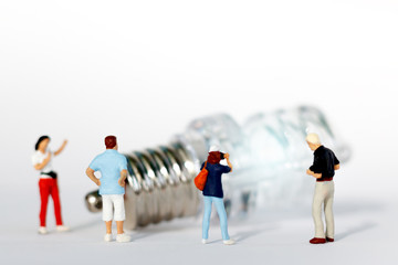 miniature people: photographer take a picture of  light bulb. idea business concept