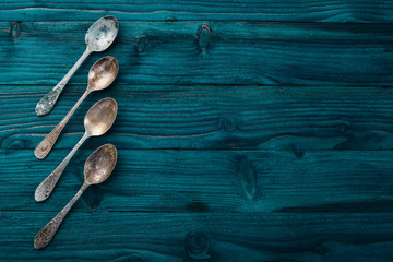 Old cutlery. On a wooden background. Top view. Free space for text.