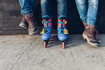 Closeup of legs of three boys in the skate park