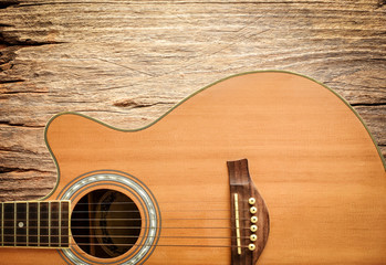 Acoustic guitar on rustic wood background