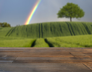 wooden table on the background fields of grain