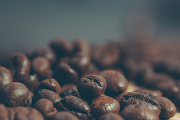 Coffee beans close up. Photo in instagram, vintage style with shallow depth of field.