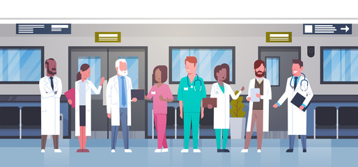 Group Of Doctors In Hospital Corridor Diverse Medical Workes In Modern Clinic Flat Vector Illustration