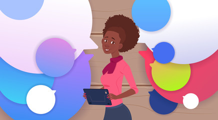 African American Businesswoman Holding Tablet Speak Over Colorful Chat Bubbles Flat Vector Illustration