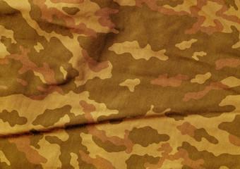 Orange color camoufklage cloth pattern.