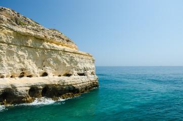 Views of white limestone cliffs and the Atlantic ocean near Benagil village, District Faro, Algarve, Southern Portugal