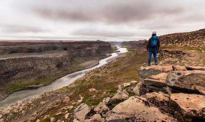 Hiker with view over Icelandic canyon / Wanderer mit Blick über Isländischen Canyon