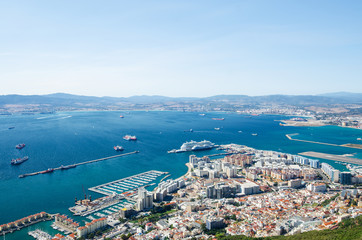 Overall view from top of the Rock of Gibraltar city, cruise port and marina, airport runway, Gibraltar Bay or Bay of Algeciras.