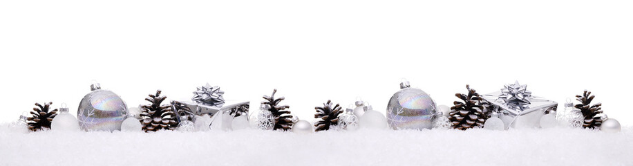 White and silver christmas balls with xmas present gift boxes in a row isolated on snow, Christmas banner