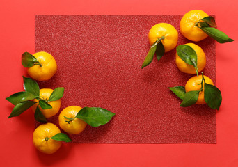 orange organic mandarins on a red background - oriental new year