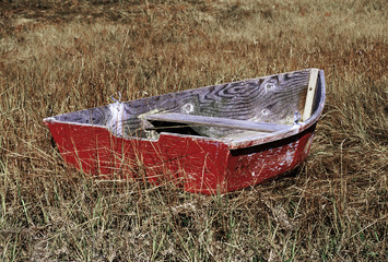 Rowboat on salt-marsh grass.