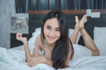 Portrait Asian sexy woman in the bed,Perfect portrait Thailand lady indoors