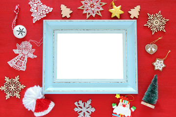 Top view of christmas festive decorations next to old photo frame. Flat lay. For photography and scrapbook montage