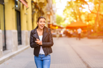 A happy young woman enjoying the autumn in a Central European ci