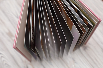 photobook with a hard cover on a wooden surface