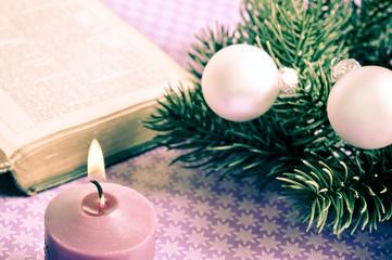 Wall Mural - open bibble with Christmas decorative balls, pine and candle like Christian Catholic Christmas