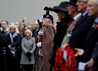 Attendees and members of the Western Front Association observe two minutes silence at the Cenotaph during a service to remember servicemen and women killed conflict, in London