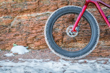 front wheel of fat bike on winter trail