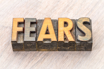 fears word abstract in wood type