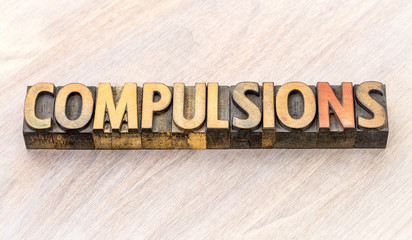 compulsions word abstract in wood type