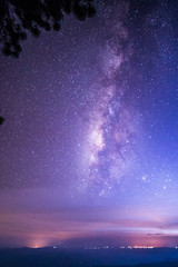 Night landscape with colorful Milky Way