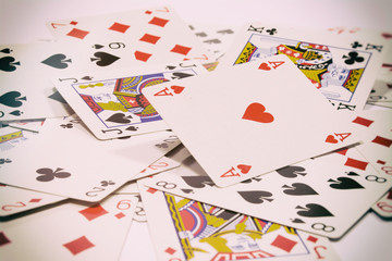 playing cards scattered on the table, background