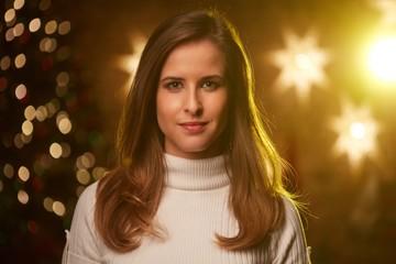 Young woman with christmas lights